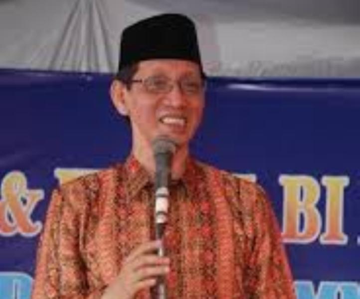Drs. H. Nurcholis Huda