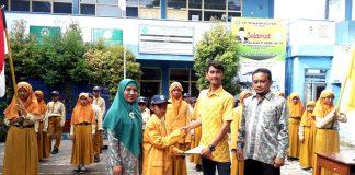 Pimpinan Ranting IPM MI Muhammadiyah Golokan dilantik. Sekertaris Umum Pimpinan Cabang (PC) IPM Sidayu Naila Dwifa Pratiwi membacakan SK pelantikan