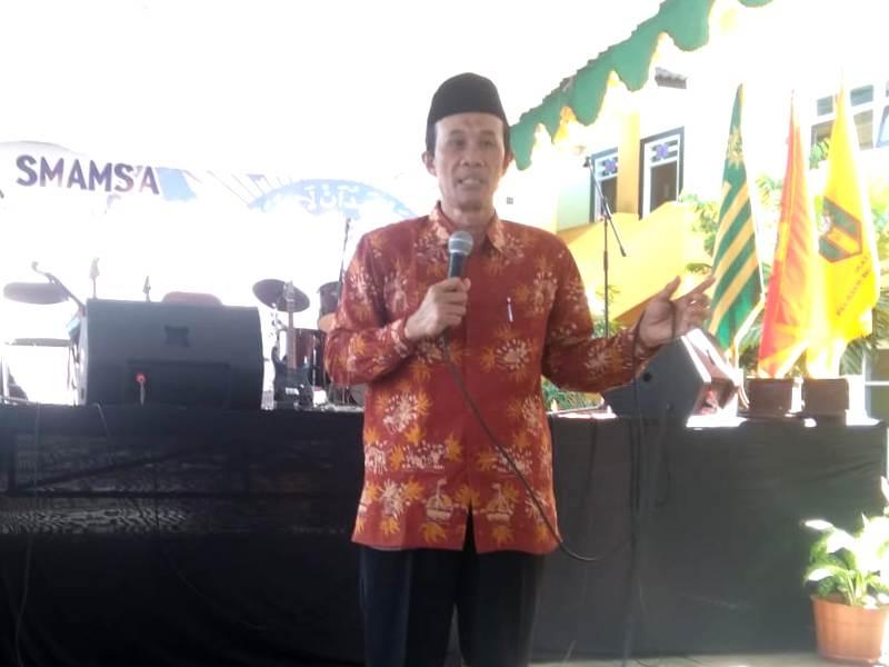 Wakil Ketua PWM Nadjib Hamid ceramah di milad SMAM 1 Kota Malang tentang peluang pemimpin menciptakan sejarah. (Uzlifah/PWMU.CO)