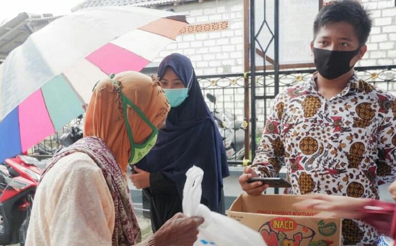 AMM Jamang Dusun Jamang Taji Kecamatan Maduran Kabupaten Lamongan menebar 250 kado Hari Raya dalam baksos, Kamis (21/5/20).